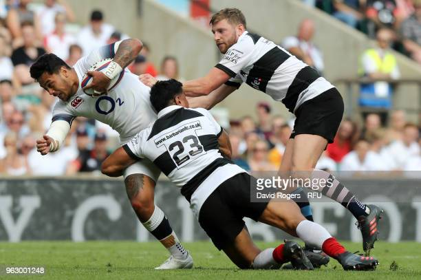 Denny Solomona of England is tackled as he attempts to break through during the Quilter Cup match between England and Barbarians at Twickenham...