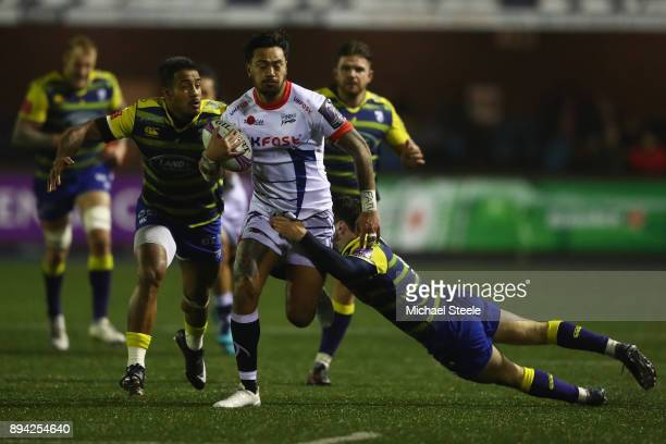Denny Solomona of Sale is tackled by Tomos Williams of Cardiff as Rey LeeLo chases down during the European Rugby Challenge Cup Pool Two match...