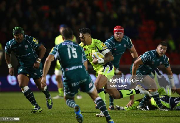 Denny Solomona of Sale Sharks breaks past the London Irish defence to score a try during the Aviva Premiership match between Sale Sharks and London...