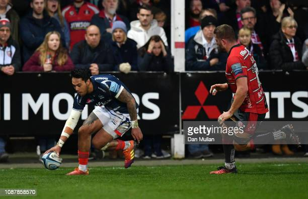 Denny Solomona of Sale Sharks goes over to score his side's fourth try during the Gallagher Premiership Rugby match between Gloucester Rugby and Sale...
