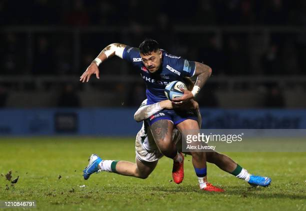 Denny Solomona of Sale Sharks is tackled by Ollie Hassell Collins of London Irish during the Gallagher Premiership Rugby match between Sale Sharks...