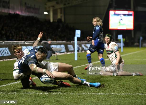 Denny Solomona of Sale Sharks scores a try as Ollie Hassell Collins of London Irish attempts to tackle during the Gallagher Premiership Rugby match...