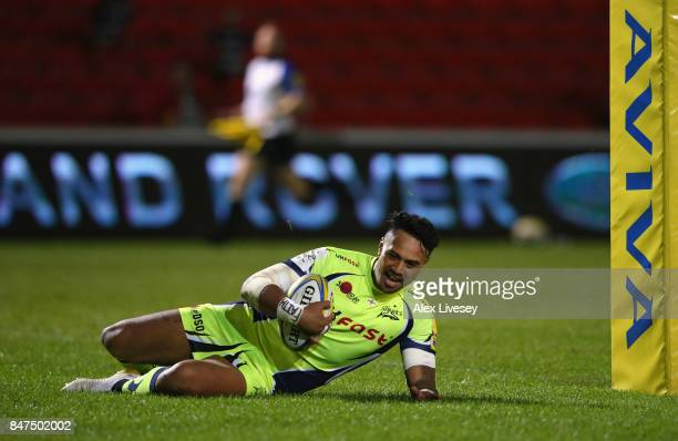 Denny Solomona of Sale Sharks slides over the line to score his second try during the Aviva Premiership match between Sale Sharks and London Irish at...