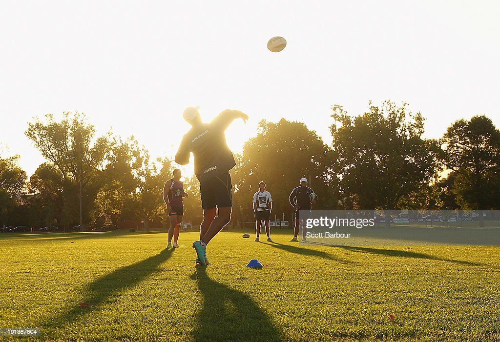 Denny Solomona of the Storm passes the ball during a Melbourne Storm NRL training session at Gosch's Paddock on February 11, 2013 in Melbourne, Australia.