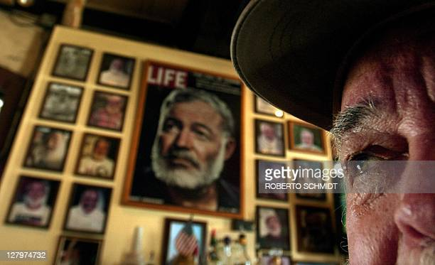 Denny Woods , winner of the 2001 Ernest Hemingway Look-a-like contest, looks past a wall of memorabilia celebrating the American author at Sloppy...
