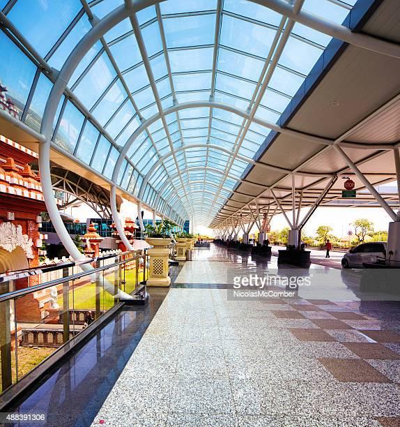 denpasar airport departure drop off outdoors glass canopy - denpasar stock pictures, royalty-free photos & images
