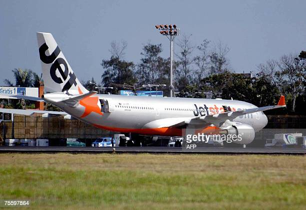 A Jetstar aircraft an Australian budget airliner sits on the tarmac after making an emergency landing at the airport in Denpasar on Bali island 23...