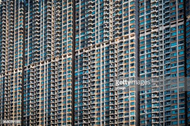 dense and highrise residential apartment blocks in hong kong - 人口爆発 ストックフォトと画像