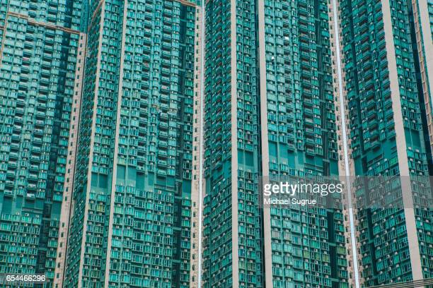 Dense apartment building in Hong Kong, seen in abstract blues and teals.