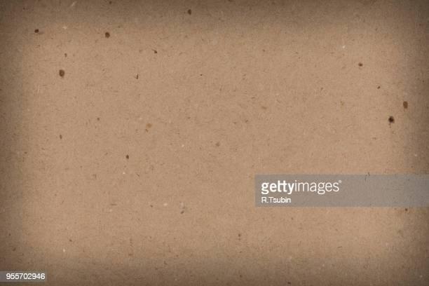 Dense cardboard paper closeup texture or background