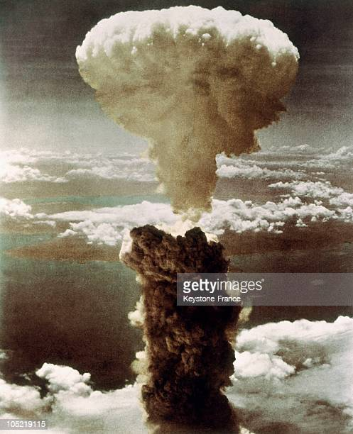 Dense column of smoke, capped by a mushroom cloud, rises more than 60,000 feet into the air over the Japanese port of Nagasaki after the explosion of...