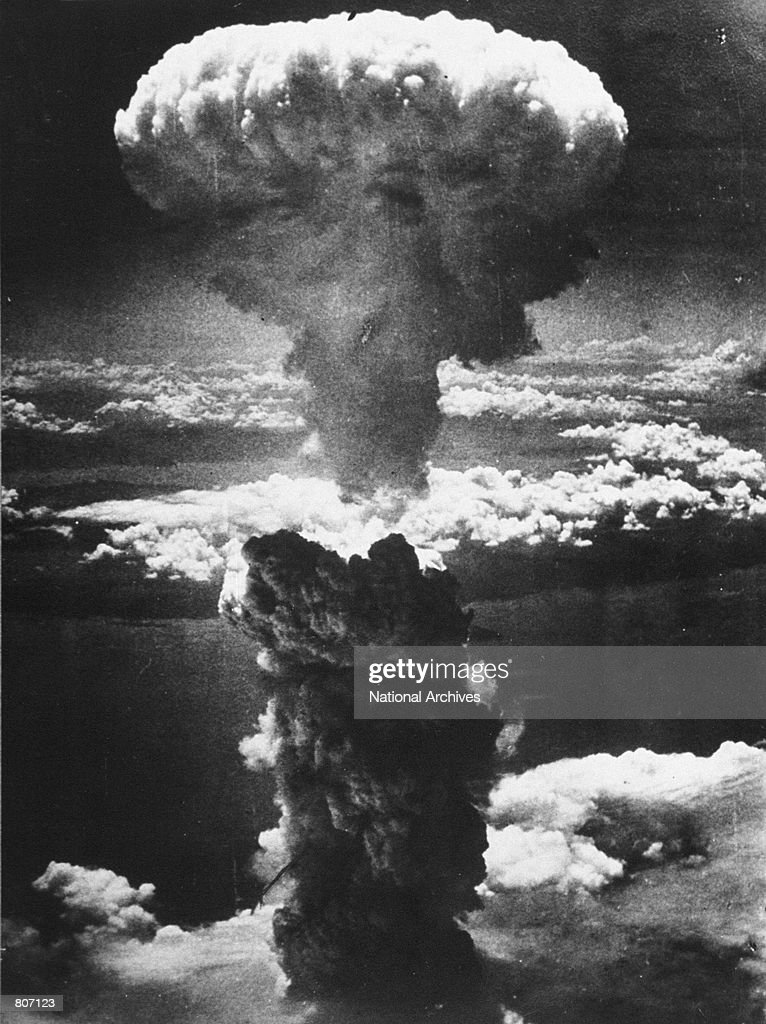 A dense column of smoke rises more than 60,000 feet into the air over the Japanese industrial port of Nagasaki, the result of an atomic bomb, the second ever used in warfare, August 8, 1945, from a U.S. Air Force B-29 Superfortress.