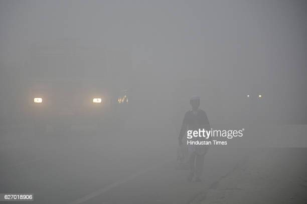 Dense fog engulfed Dasna stretches in Ghaziabad since early Thursday morning on December1 2016 in Ghaziabad India Traffic was moving slowly...