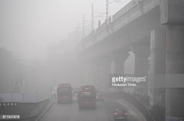 Dense fog/smog in morning resulting in very less visibility at Dhaula Kuan on November 7 2017 in New Delhi India Delhi woke up to a thick brown haze...