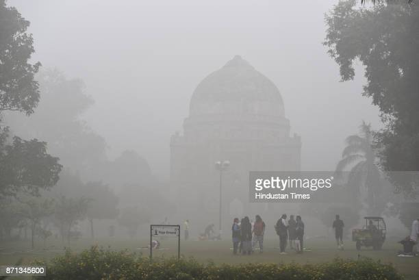 Dense fog/smog in morning resulting in very less visibility at Lodhi Garden on November 7 2017 in New Delhi India Delhi woke up to a thick brown haze...