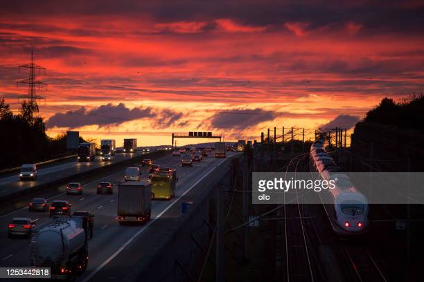 dense traffic and road users on german highway a3 near wiesbadener kreuz at dusk. - luton stock pictures, royalty-free photos & images