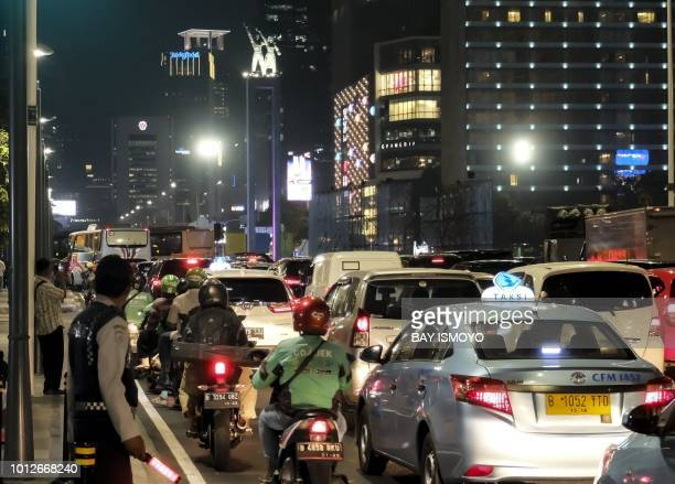 Dense traffic is seen along a main road during restrictions on vehicle usage in downtown Jakarta on August 7 prior to the start of the 2018 Asian...