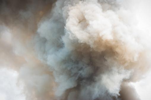 Dense white smoke rising from the raging wildfire,close up swirling white smoke background. - gettyimageskorea