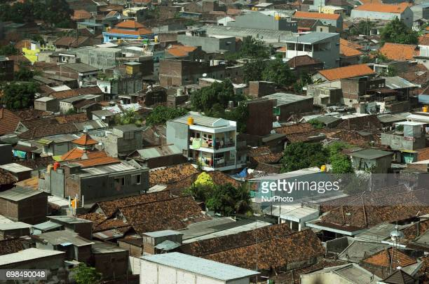 A densely populated settlement surrounded by multistorey buildings in Surabaya East Java on June2017 Indonesia succeeded to be ranked fourth with the...