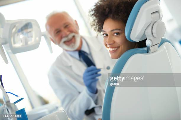 dental appointment was successful and painless. - dental equipment stock pictures, royalty-free photos & images