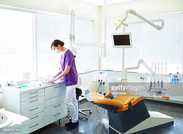 Dental assistant preparing for operation