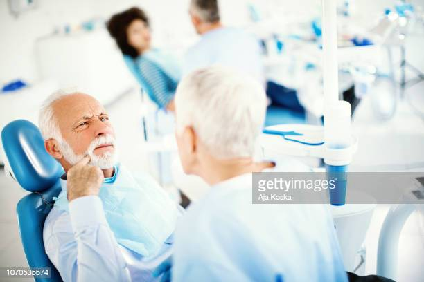 dental care for seniors. - human gums stock photos and pictures