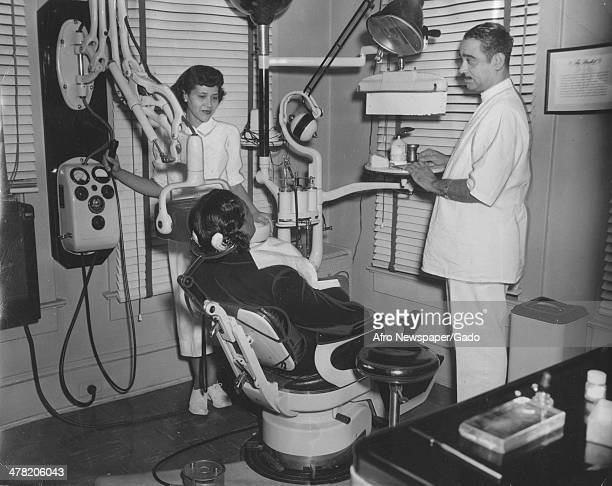 Dental clinic at Freedmen's Hospital with Mrs Portia Bullock, supervisor for elementary schools, in chair, Washington DC, 1935. Pictured are, from...