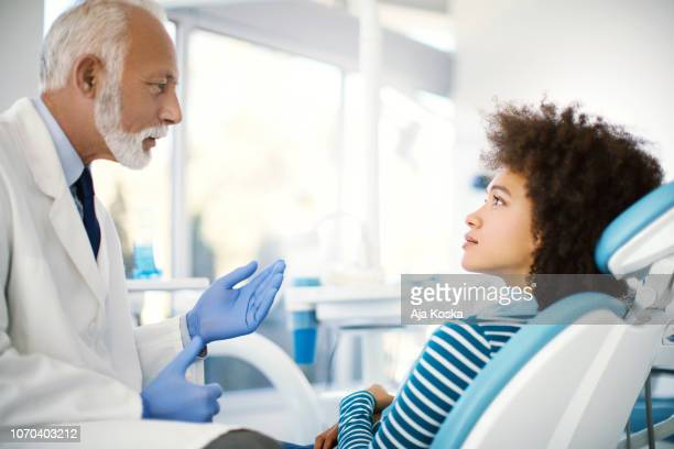 dental consultation. - dental equipment stock pictures, royalty-free photos & images