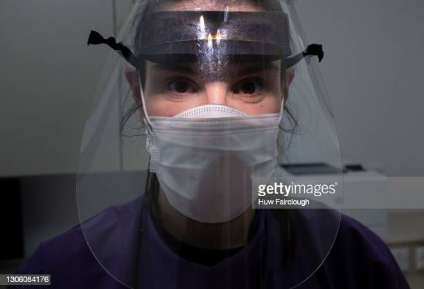 Dental Hygienist Helen Baker, who has worked through the COVID-19 pandemic providing dental care to her patients, poses for a photograph in her PPE...