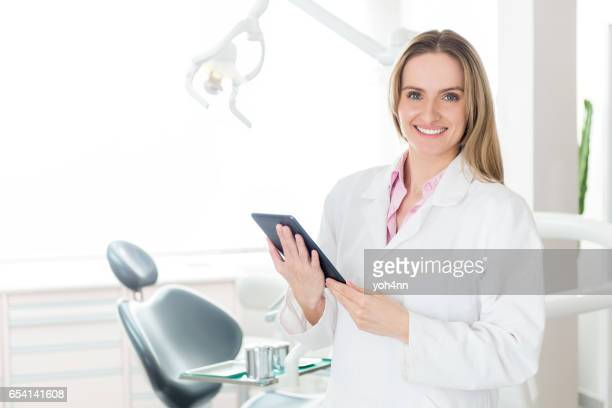 Dental hygienist with tablet