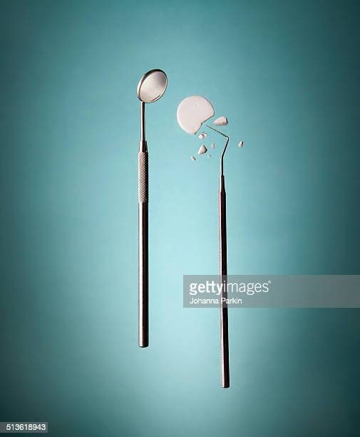 Dental instruments cracking a peppermint