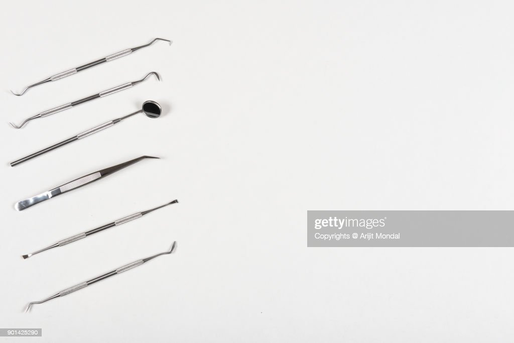 Dental Instruments On Dentists Work Desk Top View White Copy
