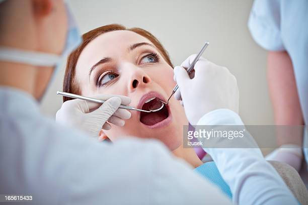 Dental Patient Getting Examined by Dentist