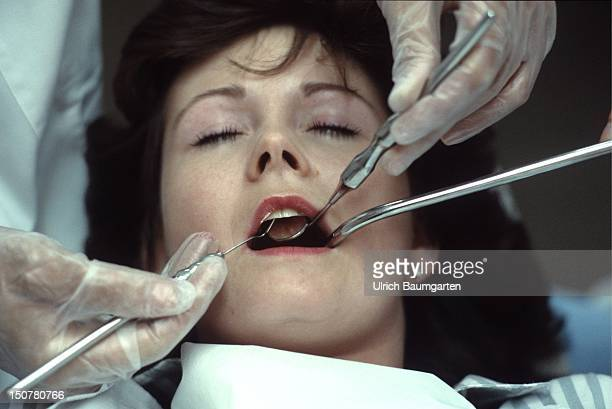 Dental treatment of a woman
