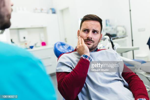 dental treatment - pain stock pictures, royalty-free photos & images