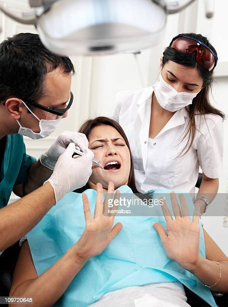 dental treatment - dental fear stock pictures, royalty-free photos & images