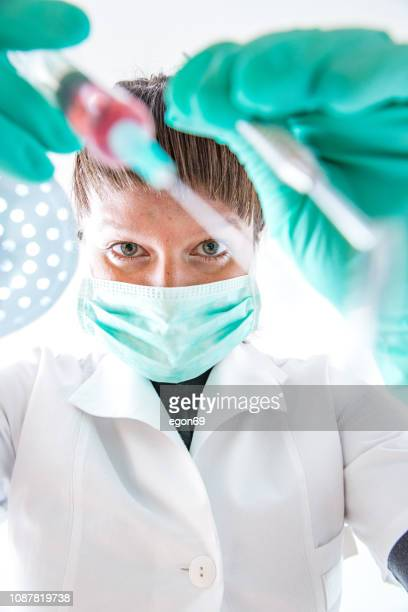 dental treatment with instrument - streptococcus mutans stock photos and pictures