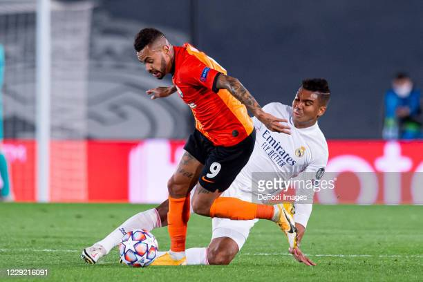 Dentinho of FC Shakhtar Donetsk and Casemiro of Real Madrid battle for the ball during the UEFA Champions League Group B stage match between Real...