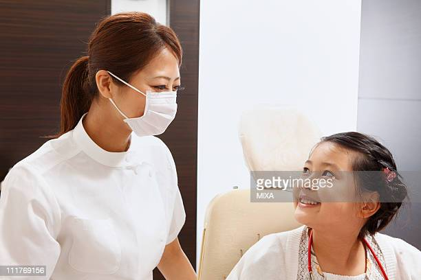 Dentist and Girl Smiling