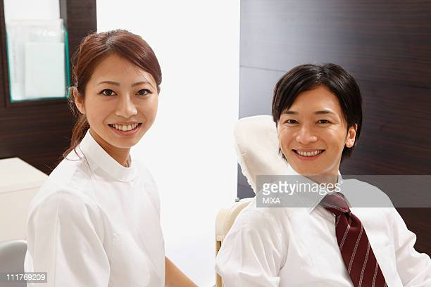 Dentist and Mid Adult Man Smiling