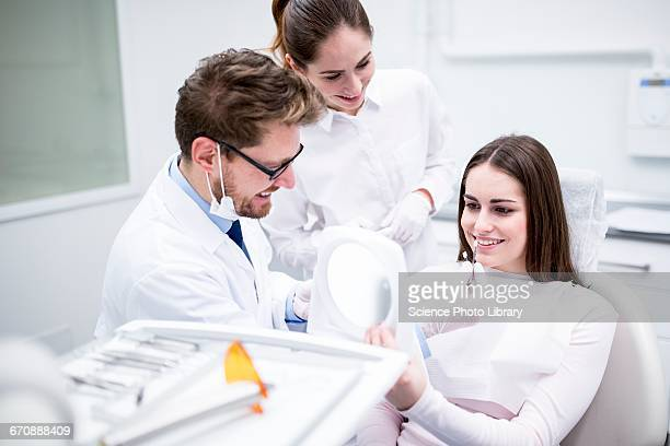 Dentist and patient with tooth veneers