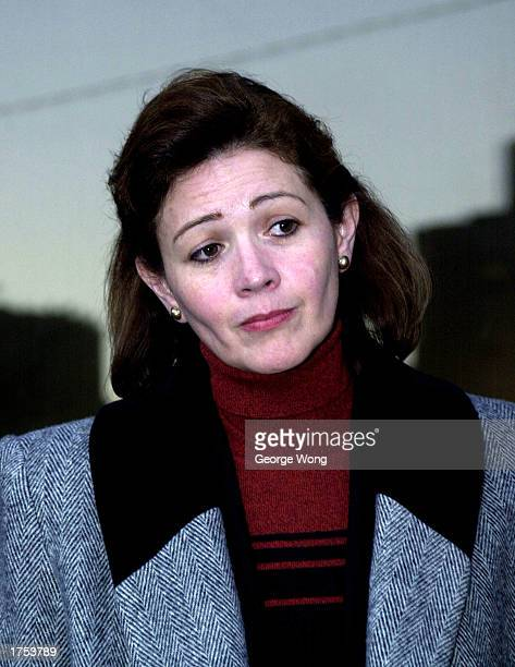 Dentist Clara Harris appears before the media after her first day of testimony January 30 2003 in Houston Texas Harris is charged with murdering her...