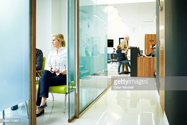 dentist clinic with waiting room and reception - clinic stock pictures, royalty-free photos & images
