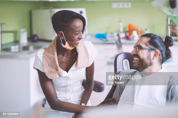 Dentist consulting her patient
