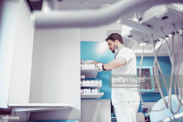 Dentist Doctor Archiving Patients Prosthesis Exam in His Clinic