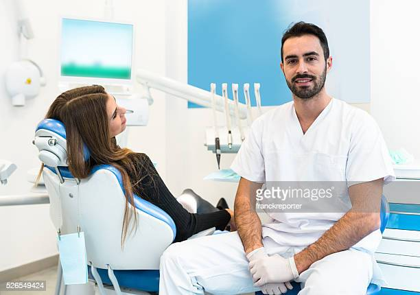 dentist doctor with patient in the clinic ready to work