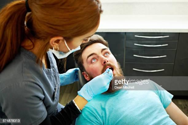 Dentist examining a patient in dental clinic