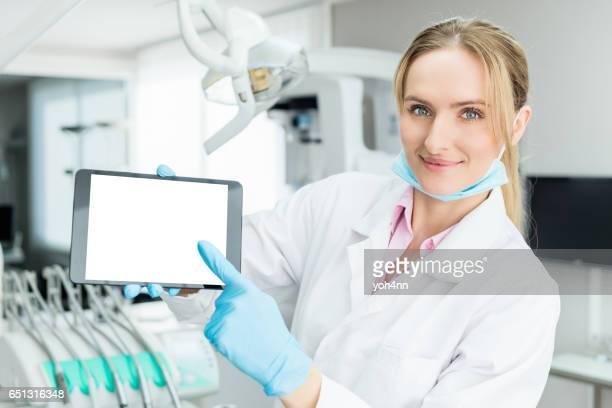 Dentist holding blank screen digital tablet