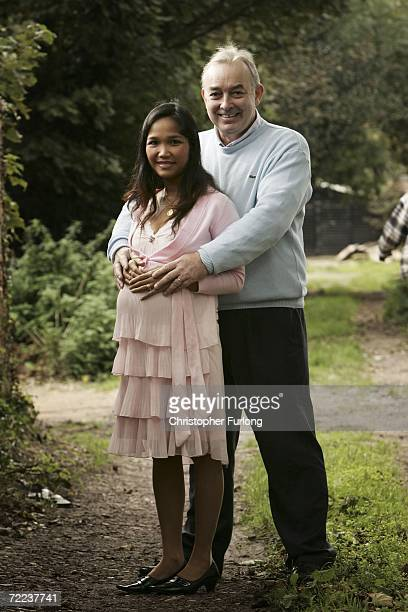 Dentist Ken Moylan poses with his wife Wan who is expecting their third child enjoy a social occasion at the Wat Sanghathan Buddhist Temple on...
