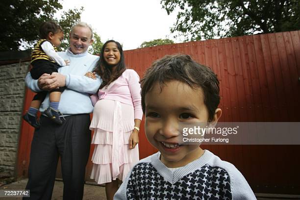 Dentist Ken Moylan poses with his wife Wan who is expecting their third child and children Daniel aged three and Jack one as they enjoy a social...